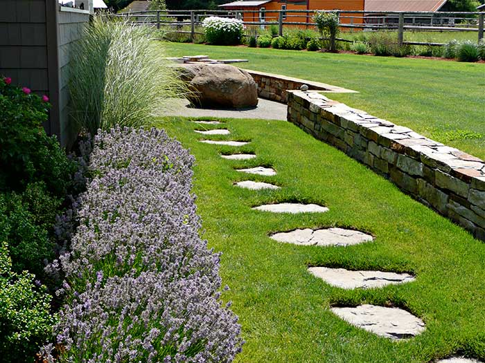 In Another Part Of The Same Property Flagstone Stepping Stones Set Into Lawn Create
